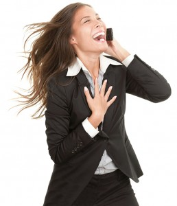 Woman laughing on mobile phone isolated